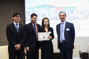 Representatives from DaeYang Immigration Corporation, a new IIUSA member, are presented their membership certificate by IIUSA Director of Events & Business Development McKenzie Penton and IIUSA Director of Data Analytics Lee Li